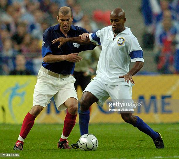 France and Brazil play a friendly soccer game at the Stade de France to celebrate the 100th anniversary of the FIFA Brasilian Luisao fights for the...