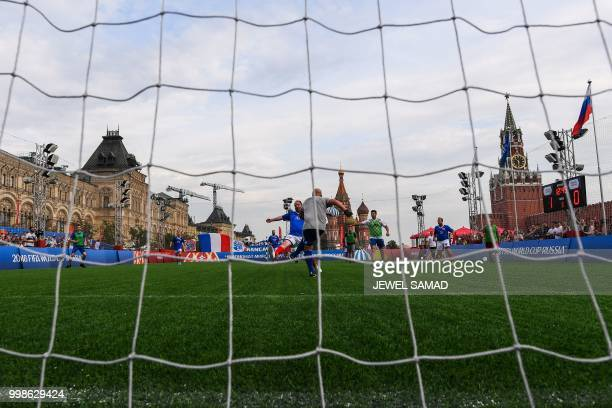France and Croatia fans play a friendly amateur football match at the Red Square in Moscow on July 14 2018 on the eve of the Russia 2018 World Cup...