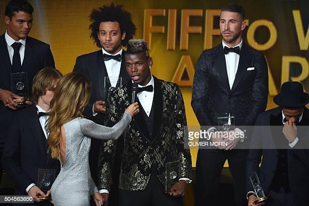 France and Juventus midfielder Paul Pogba speaks flanked by Brazil and Paris SaintGermain defender Thiago Silva Croatia and Real Madrid midfielder...