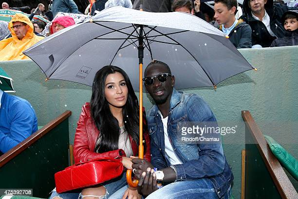 France and Liverpool professional footballer Mamadou Sakho and his companion Matja attend the 2015 Roland Garros French Tennis Open Day Eight on May...
