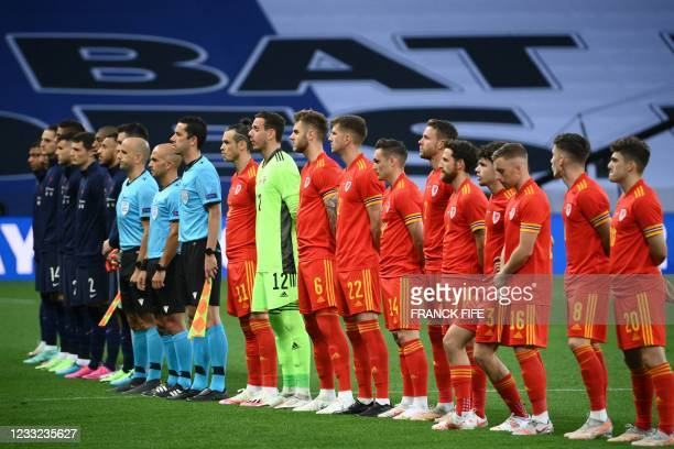 France and Wales teams line up before the friendly football match between France and Wales at the Allianz Riviera Stadium in Nice, southern France on...
