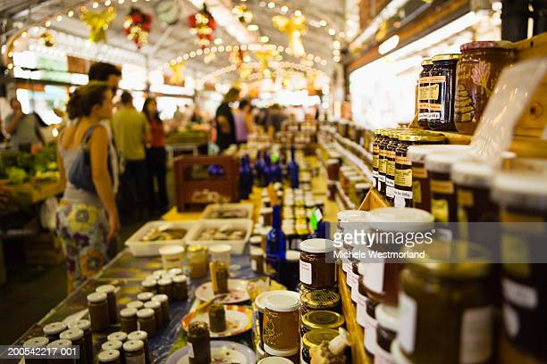 France, Antibes, people shopping at market (focus on jam)