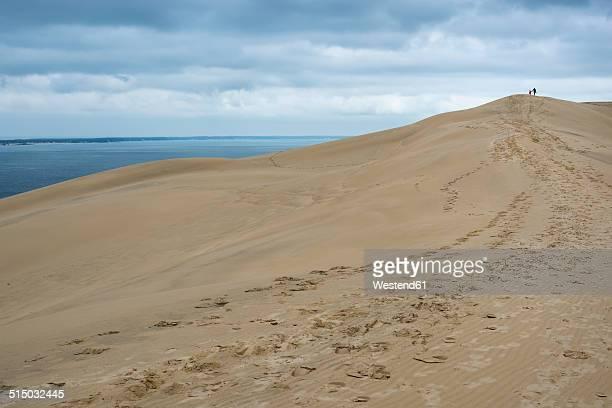 France, Aquitaine, Gironde, Pyla sur Mer, Dune du Pilat, mother and daughter walking on sand dune