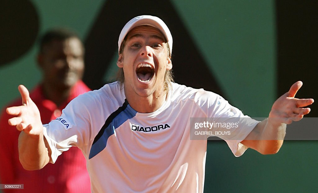 Argentinian Gaston Gaudio celebrates after defeating Argentinian Guillermo Coria in their men's final match during the French Open at Roland Garros in Paris 06 June 2004.