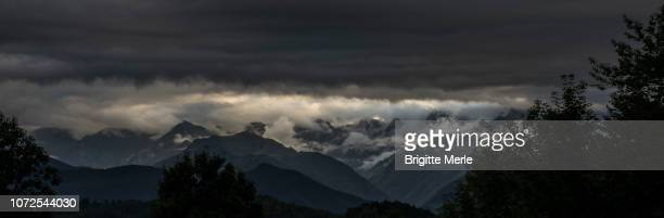 france, ariege, clouds and dusk on the mount valier - アリエージュ ストックフォトと画像