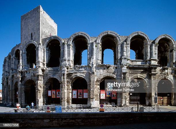 France Arles Detail view The two rows of stone arches of the Roman amphitheater of Arles with a tower on the left made in medieval times