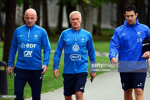 France assistant coach Guy Stephan head coach Didier Deschamps and the coach for goalkeeper Franck Raviot arrive a training session at the French...