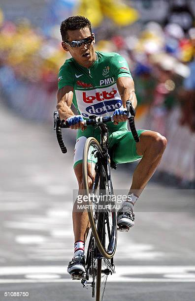 L'ALPE D'HUEZ France Australian Robbie MC Ewen crosses the finish line of the 16th stage of the 91st Tour de France cycling race a time trial between...
