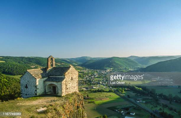 france, auvergne, cantal, chapel sainte-madeleine on a rocky outcrop over la vallee de l'alagnon at massiac - cantal stock pictures, royalty-free photos & images