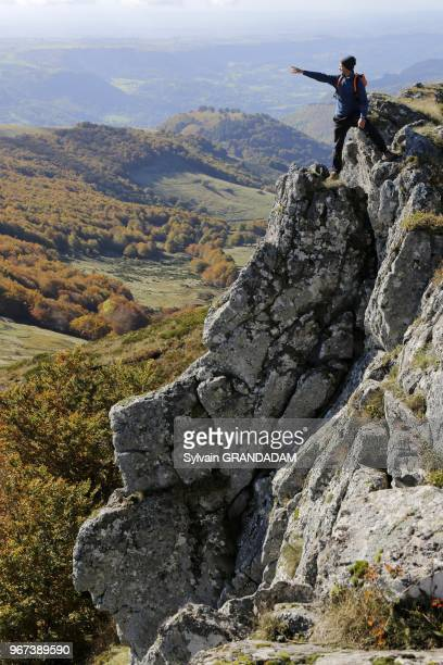 France, Auvergne, Cantal , natural regional park of the Auvergne volcanos, hiking from Col du Pertus up to the top of l'Elanceze rock, man on top...