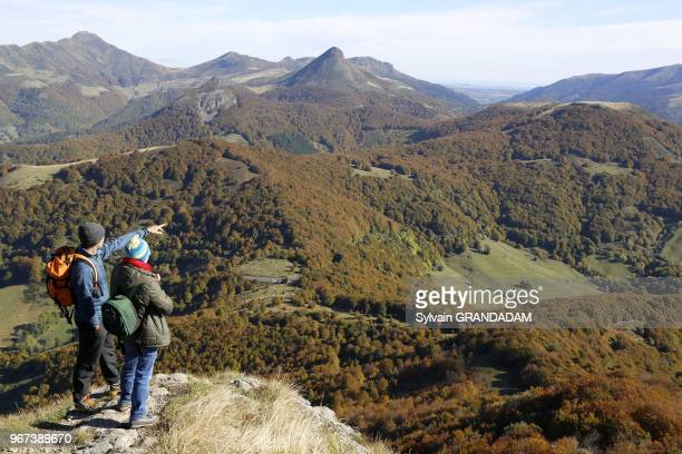 France, Auvergne, Cantal , natural regional park of the Auvergne volcanos, hiking from Col du Pertus up to the top of l'Elanceze rock, couple of...