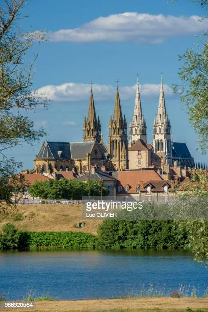france, auvergne-rhones-alpes, allier, moulins, former capital of the dukes of burgundy seen from the left bank of the allier river with both the steeples of notre-dame cathedral and saint-pierre church - allier stock photos and pictures