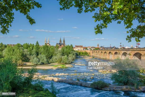 france, auvergne-rhones-alpes, allier, moulins, former capital of the dukes of burgundy seen from the left bank of the allier river, regemortes bridge and both the steeples of notre-dame cathedral and saint pierre church - allier stock photos and pictures