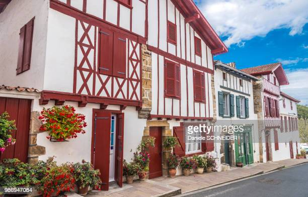 France, Basque Country, Bastide-Clairence (labelled 'Most Beautiful Village in France'), alignment of houses in regional style