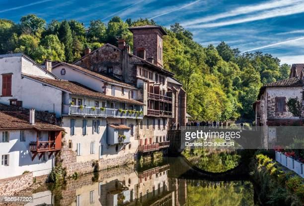 """france, basque country, houses on the edge of the nive river in saint-jean-pied-de-port (labelled """"most beautiful village in france"""") - saint jean pied de port stock photos and pictures"""