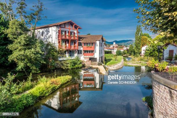 """france, basque country, river nive in saint-jean-pied-de-port (labelled """"most beautiful village in france"""") - saint jean pied de port stock photos and pictures"""