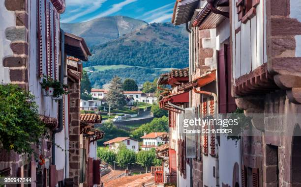 """france, basque country, saint jean pied de port (labelled """"most beautiful village in france""""), alignment of typical houses - saint jean pied de port stock photos and pictures"""