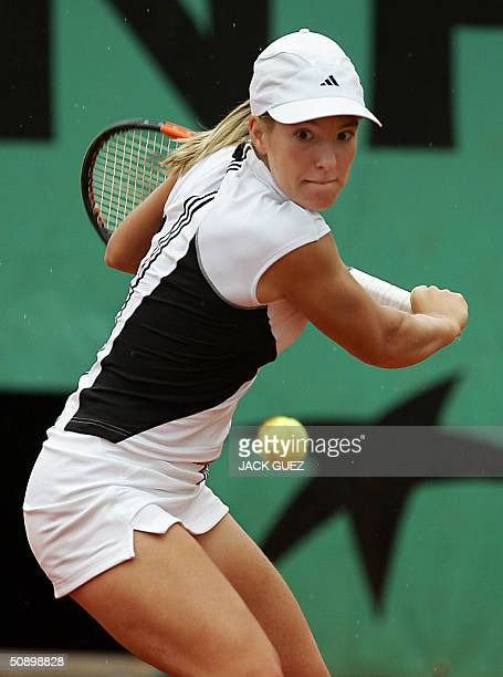 Belgian Justine HeninHardenne hits a backhand during her match against Italian Tathiana Garbin on the second round of the French tennis open at...