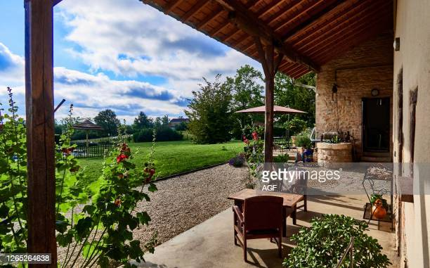 France. Bourg-en-Bresse. Ain department. Malafretaz village. The inner courtyard of my country house with its door and shutters and its outdoor...