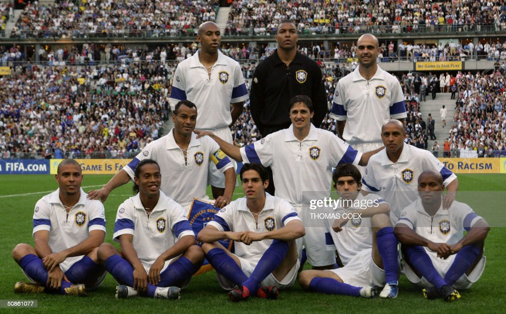 Brazil's team poses before the FIFA Centenary football match between France and Brazil at the Stade de France in Saint-Denis, outside Paris, 20 May 2004.