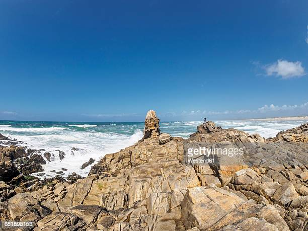 France, Bretagne, Finistere, Man standing at Atlantic coast