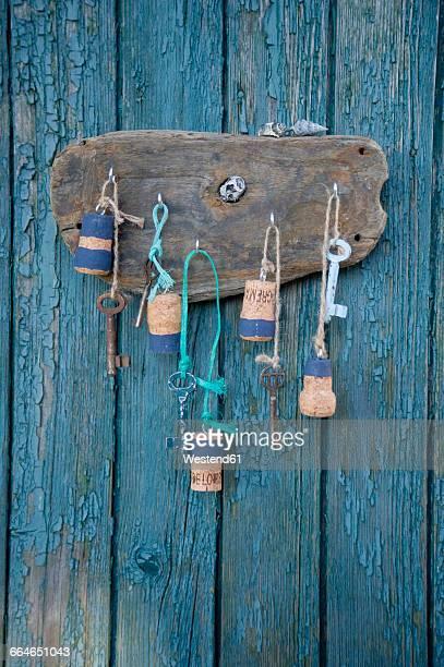 France, Bretagne, old keys on key rack, corks and mussels