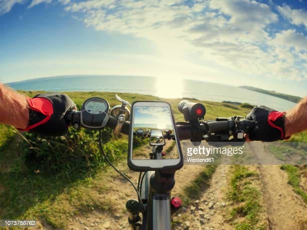 france, bretagne, sainte-anne la palud, plage de treguer, cell phone on mountain e-bike - handlebar stock photos and pictures