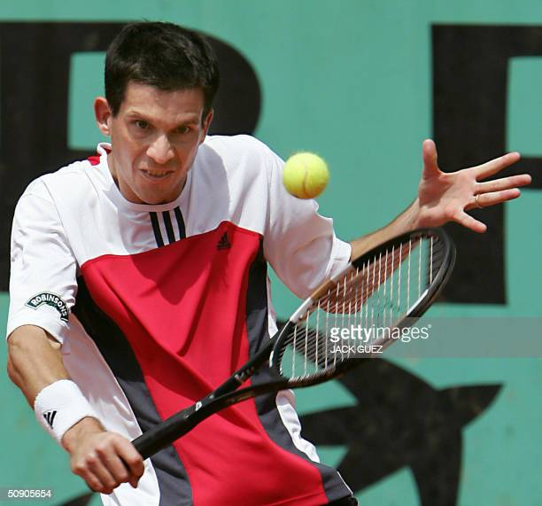 British Tim Henman hits a backhand to Spanish Galo Blanco on the third round of the French tennis open at Roland Garros in Paris 28 May 2004 AFP...