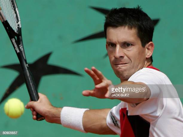 British Tim Henman hits a forehand to Spanish Galo Blanco on the third round of the French tennis open at Roland Garros in Paris 28 May 2004 AFP...