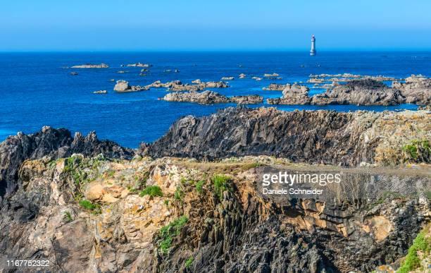 france, brittany, ile d'ouessant, la jument lighthouse, south coast - la jument stock pictures, royalty-free photos & images
