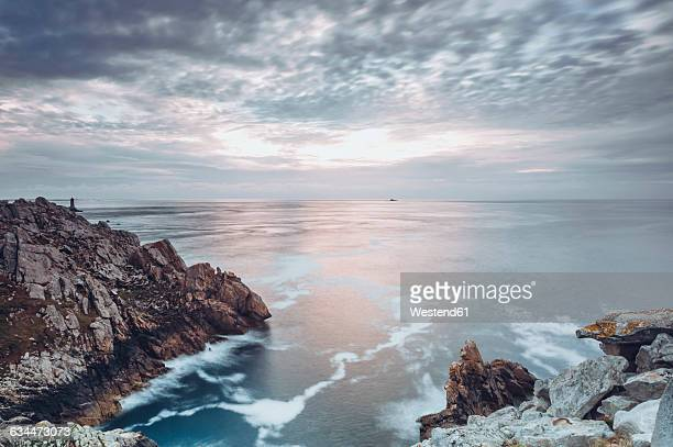 France, Brittany, Pointe du Raz, sunset at the coast