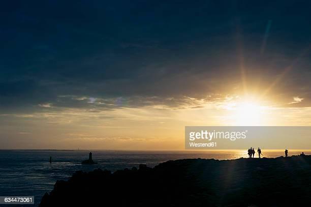 France, Brittany, Pointe du Raz, sunset at the coast with lighthouses Phare de la Vieille and Phare de Tevennec