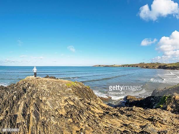 France, Brittany, Sainte-Anne-la-Palud, senior man at the beach Treguer plage