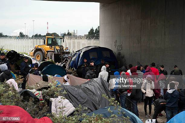 France Calais camp for refugees known as 'The Jungle' September 21st 2015 French police oversee the removal of the tents and beongings in them from...