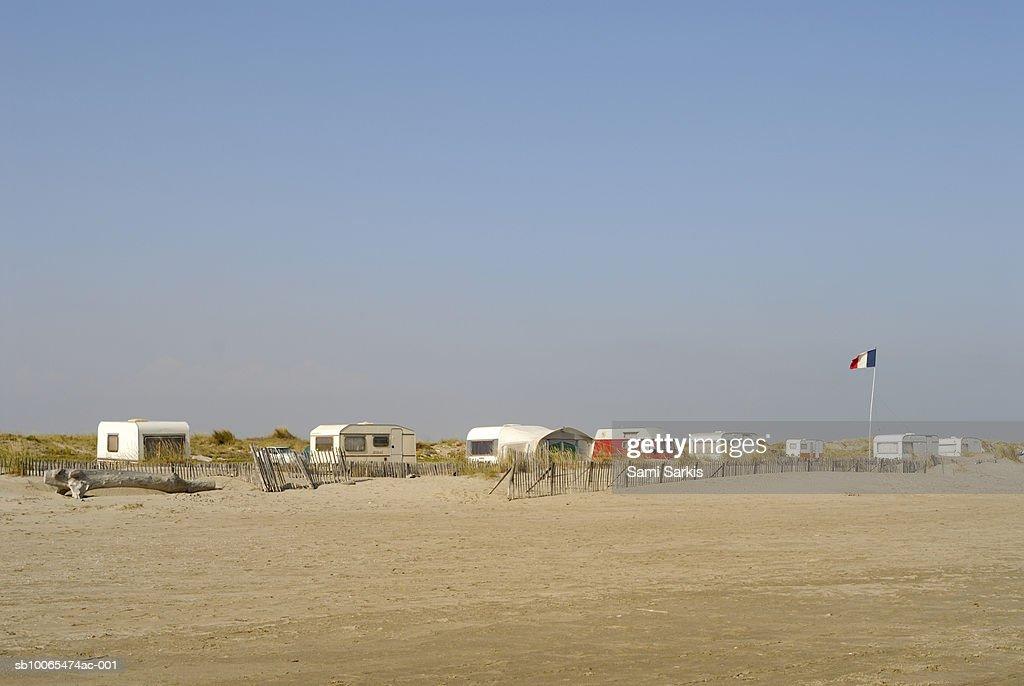 France, Camargue, caravans parked on beach : Stock Photo