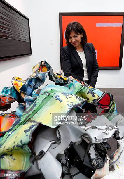 CAPTION France' candidate for the 2014 mayoral elections in Paris and Paris socialist deputy mayor Anne Hidalgo looks at a work by US artist John...