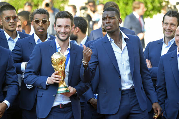 FOOT MASCULIN COUPE DU MONDE 2018 - Page 36 France-captain-hugo-lloris-and-paul-pogba-react-as-he-holds-the-as-picture-id1000326864?k=6&m=1000326864&s=612x612&w=0&h=bnAFIJliMTza76Ut5P0ulHZIMeyWFyX8lVnwmEA1gHI=