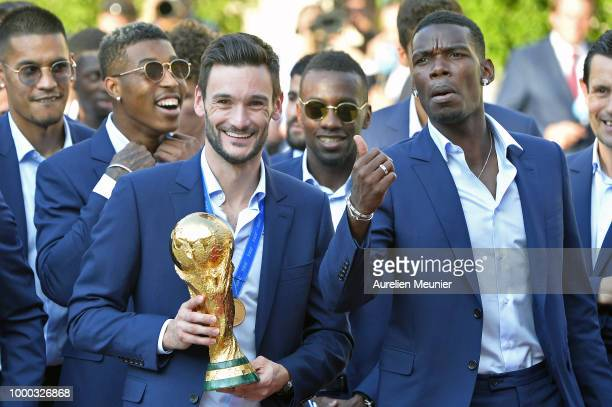 France Captain Hugo Lloris and Paul Pogba react as he holds the trophy as French President Emmanuel Macron receives the France football team during a...