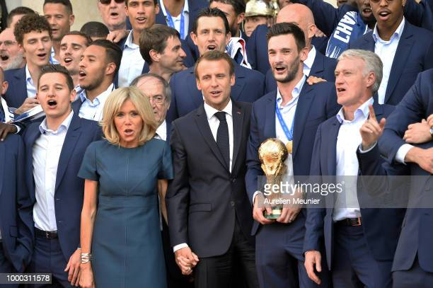 France Captain Hugo Lloris French First Lady Brigitte Macron Didier Deschamps and Florian Thauvin react as French President Emmanuel Macron receives...