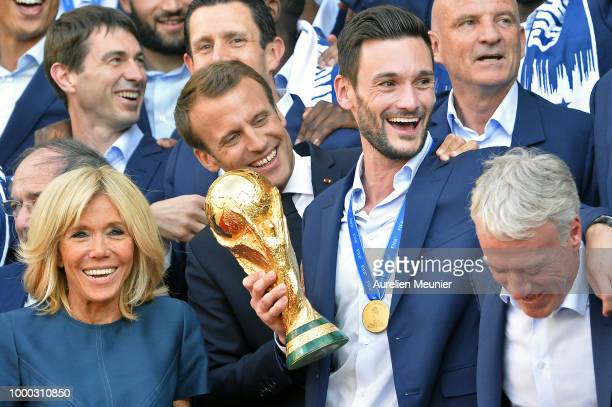 France Captain Hugo Lloris French First Lady Brigitte Macron react as French President Emmanuel Macron receives the France football team during a...