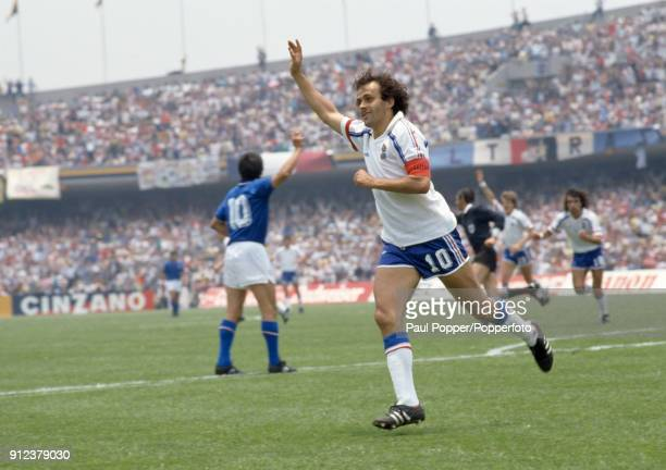 France captain Michel Platini celebrates after scoring during the FIFA World Cup match between Italy and France at the Estadio Olympico Universitario...
