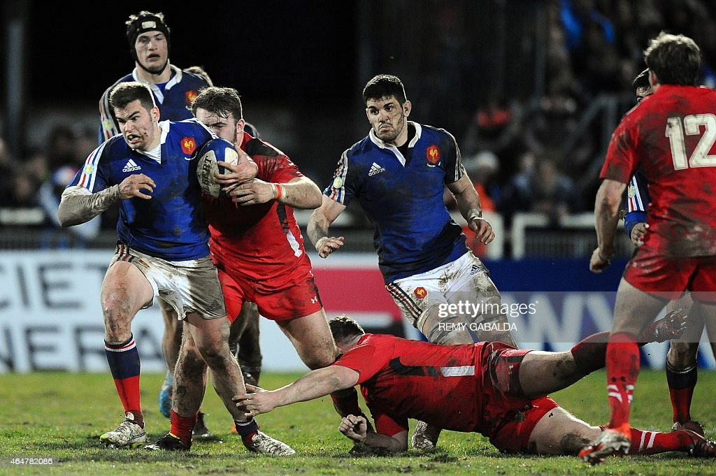 France center Damian Penaud runs with the ball during the U20 rugby union match, France vs Galles, at the Jules Ribet stadium in Saint-Gaudens southwestern France, on February 28, 2015.