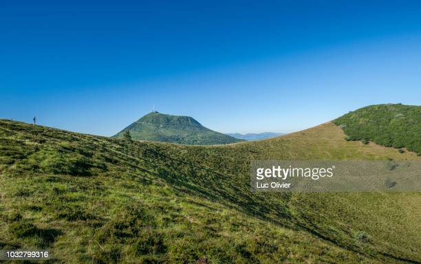 france, center france, chaine des puys, hiking on the crater of the puy pariou - auvergne stock pictures, royalty-free photos & images