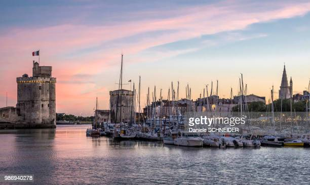 france, charente-maritime, la rochelle, the vieux port with the towers of la lanterne, la chaine and saint nicolas - la rochelle stock pictures, royalty-free photos & images