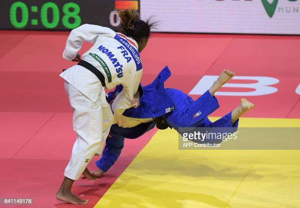 France' Clarisse Agbegnenou competes with Spain's Isabel Puche during their match in the womens 63kg category at the World Judo Championships in...