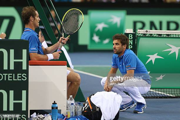 France coach Arnaud Clement shares few words with Richard Gasquet of France during his match against Dudi Sela of Israel on day one of the Davis Cup...