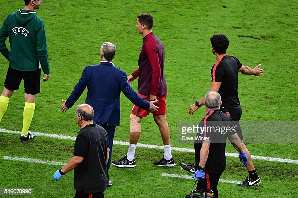 France coach Didier Deschamps complains to the fourth official about Cristiano Ronaldo of Portugal and the Portuguese backroom staff invading his...