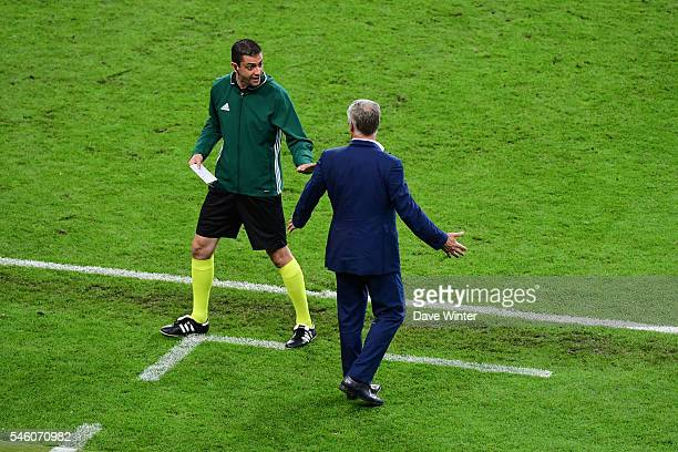 France coach Didier Deschamps complains to the fourth official Victor Kassai about Cristiano Ronaldo of Portugal and the Portuguese backroom staff...