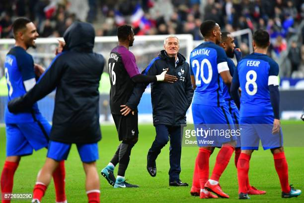 France coach Didier Deschamps greets Steve Mandanda of France after the international friendly match between France and Wales at Stade de France on...