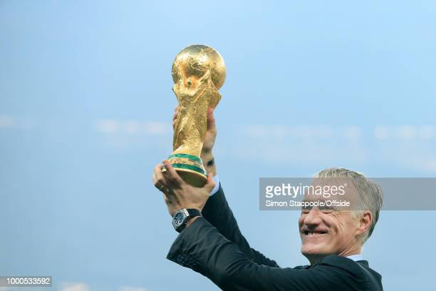 France coach Didier Deschamps holds the trophy aloft after the 2018 FIFA World Cup Russia Final between France and Croatia at the Luzhniki Stadium on...